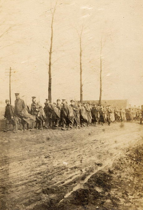 Soldiers of the 7th Battalion, The Durham Light Infantry, marching along a road in France or Belgium, c.1914-1918 (D/DLI 2/7/18(223)) - click to enlarge