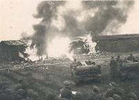 Photograph of flame thrower burning huts (D/DLI 7/404/42) - Copyright © Durham County Record Office.