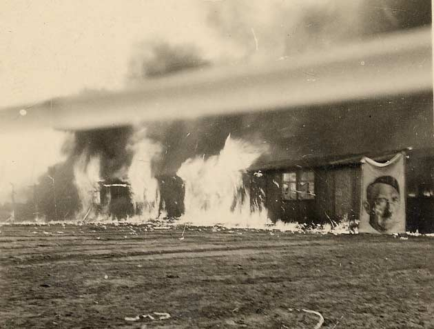 Photograph of burning huts (D/DLI 7/404/73) - Copyright © Durham County Record Office.