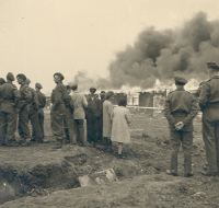Photograph of burning the last hut at Belsen, 21 May 1945 (D/DLI 7/404/28(47)) - Copyright © Durham County Record Office.