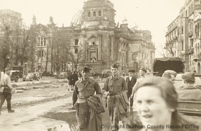 The Reichstag black market, Berlin, August-September 1945. Note the US and Soviet soldiers. Photograph from Roy Griffiths' album (D/DLI 7/273/16(27))