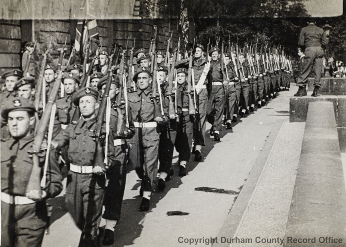 9th Battalion DLI Guard of Honour for a meeting of the Allied Control Council in Berlin, 20 September 1945. Lieutenant Alan Capstick is carrying 9 DLI's Regimental Colour. Photograph from Alan Capstick's collection (D/DLI Acc: 10050)